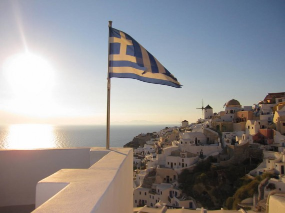 View of Santorini and the Greek Flag Waving