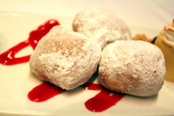 Fresh-N'-Hot Doughnut Holes w/ Raspberry Sauce at RED Steakhouse